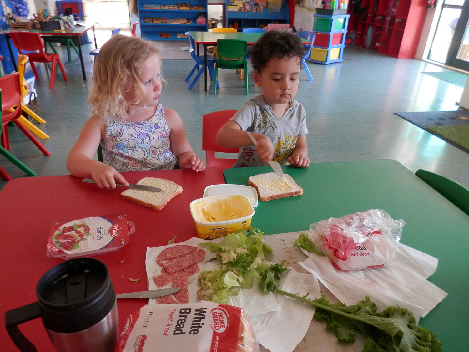 Making sandwiches with lettuce from our garden